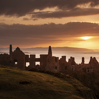 Buy canvas prints of Sunset over Dunluce Castle by David McFarland