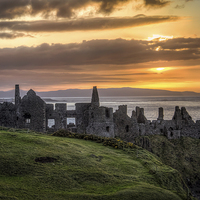 Buy canvas prints of Dramatic Dunluce Sunset by David McFarland