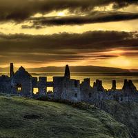 Buy canvas prints of Dunluce Castle Sunset by David McFarland