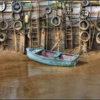 Buy canvas prints of Tyred Boat 2013 by Martin Parkinson