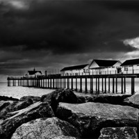 Buy canvas prints of Southwold Pier on a Stormy Day by Paul Macro