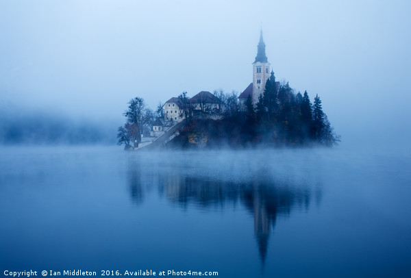 Misty Lake Bled Canvas Print by Ian Middleton
