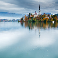 Buy canvas prints of Autumn colours at Lake Bled by Ian Middleton