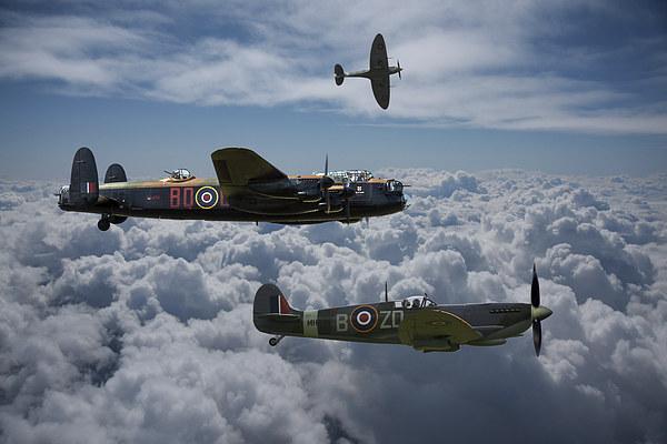 Lancaster with Spitfire escort Canvas print by Ken Brannen