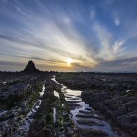 Buy canvas prints of Black Rock Widemouth Bay by David Wilkins