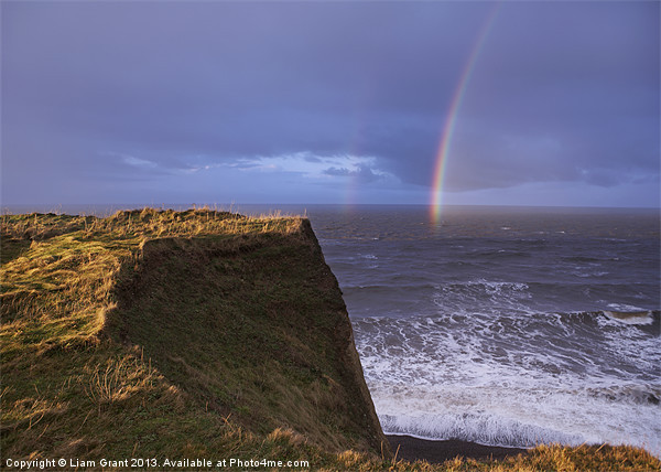 Rainbow out at sea, Peddars Way Coastal Path, Sher Canvas print by Liam Grant