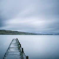 Buy canvas prints of Jetty on Lake Windermere with Langdale Pikes beyond. by Liam Grant
