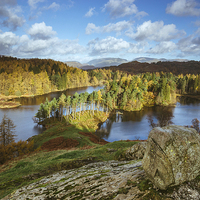 Buy canvas prints of Sunlight over Tarn Hows with Helvellyn beyond. by Liam Grant