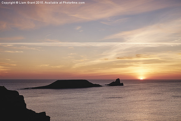 Worms Head at sunset. Wales, UK. Canvas print by Liam Grant
