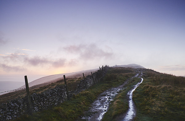 Mountain path and fence at sunset. Derbyshire, UK. Canvas print by Liam Grant