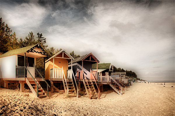 Beach Huts at Wells Canvas print by Simon Wrigglesworth