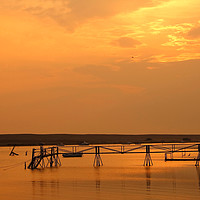 Buy canvas prints of Sunset Over The Fleet by Nicola Clark