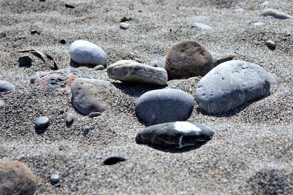 Pebbles on a Cretan Beach Canvas print by Peter Elliott