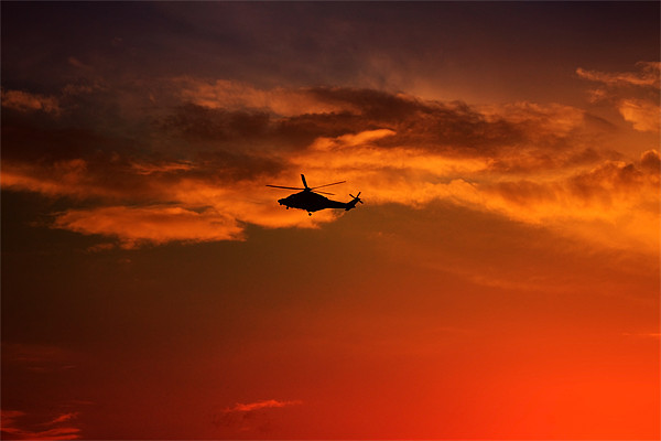Helicopter At Sunset Canvas print by Ian Jeffrey