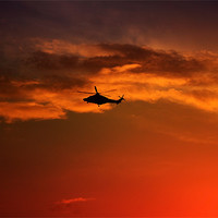 Buy canvas prints of Helicopter At Sunset by Ian Jeffrey