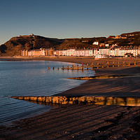 Buy canvas prints of Evening at Aberystwyth North Beach by Izzy Standbridge
