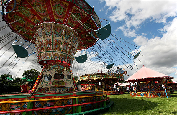 Fairground chair-o-planes ride Canvas print by Tony Bates