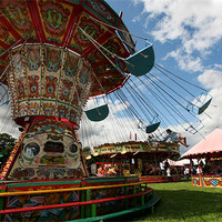Buy canvas prints of Fairground chair-o-planes ride by Tony Bates