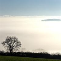 Buy canvas prints of Peeping through the mist by Pete Hemington
