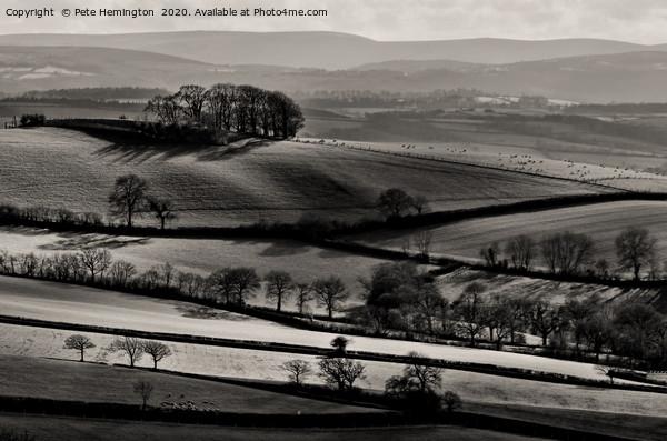 Light on rolling hills in Mid Devon Canvas Print by Pete Hemington