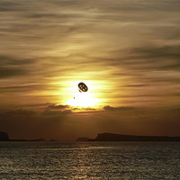 Buy canvas prints of Parasailing at sunset by Sam Smith