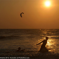 Buy canvas prints of Playing in the Sea at Sunset Mandrem by Serena Bowles