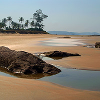 Buy canvas prints of Rocks and Pools on Sandy Beach, Goa by Serena Bowles