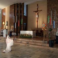 Buy canvas prints of Praying Woman in Keralan Church, India by Serena Bowles