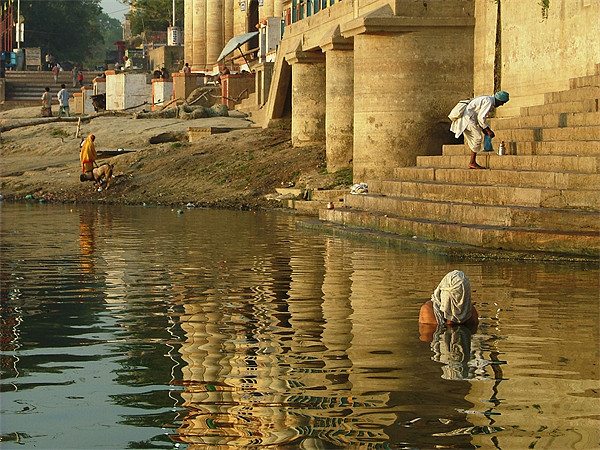 Bathing in the Ganges Framed Print by Serena Bowles