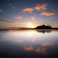 Buy canvas prints of Bamburgh Castle at Dawn by Paul Appleby