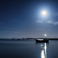 Buy canvas prints of Holy Island Harbour under a Blue Moon by Paul Appleby