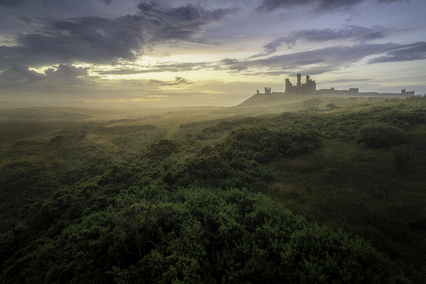Mist over Dunstanburgh Canvas print by Paul Appleby