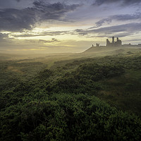 Buy canvas prints of Mist over Dunstanburgh by Paul Appleby