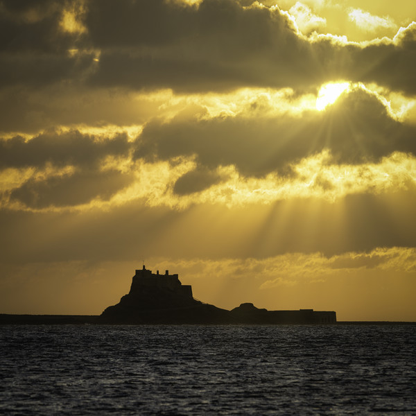 Rays of Hope Over Lindisfarne Canvas print by Paul Appleby