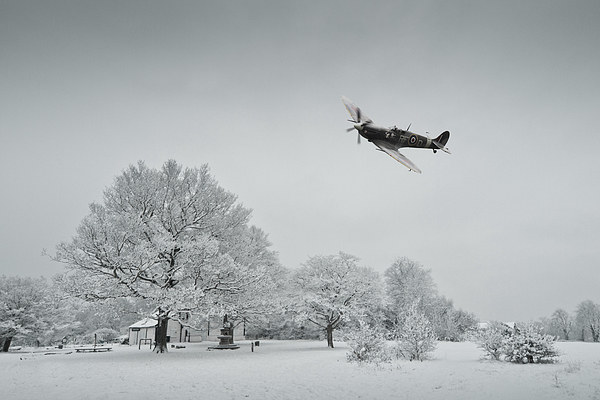 A Spitfire Winter  Canvas Print by J Biggadike