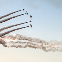 Buy canvas prints of Red Arrows smoke trails  by J Biggadike