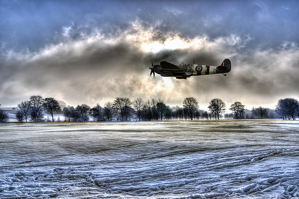 Spitfire Fly Past  Canvas Print by J Biggadike
