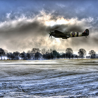 Buy canvas prints of Spitfire Fly Past  by J Biggadike