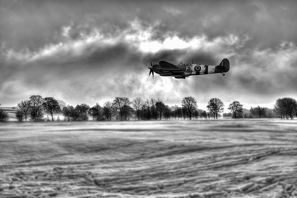 Spitfire Fly Past - Mono  Canvas Print by J Biggadike