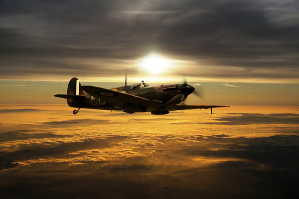 Spitfire In The Sun Canvas Print by J Biggadike
