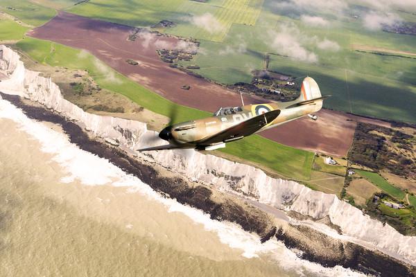 The Duxford Spitfire Canvas Print by J Biggadike