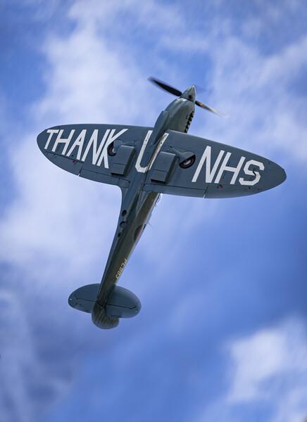 NHS Spitfire Framed Print by J Biggadike