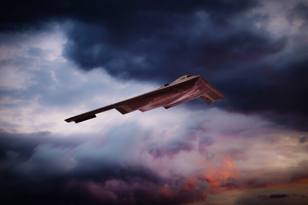 B-2 Sunset Canvas Print by J Biggadike