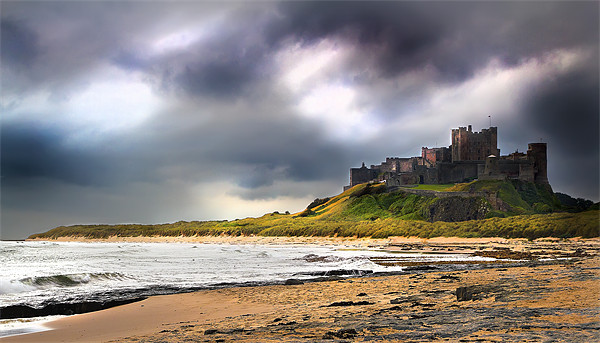 Stormy sky over Bamburgh Castle Canvas print by Kevin Tate