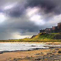 Buy canvas prints of Stormy sky over Bamburgh Castle by Kevin Tate