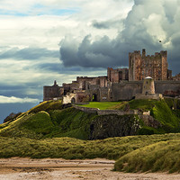 Buy canvas prints of Cloudy Bamburgh Castle by Kevin Tate