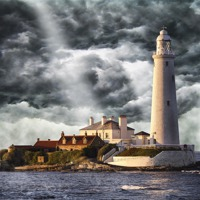 Buy canvas prints of Stormy Skies at St Marys Lighthouse by Kevin Tate