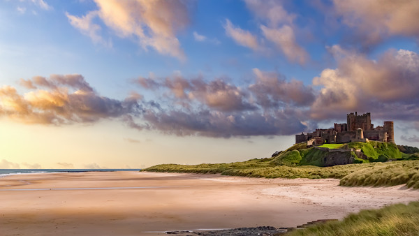 Bamburgh Castle and Beach Framed Print by Kevin Tate