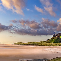Buy canvas prints of Bamburgh Castle and Beach by Kevin Tate
