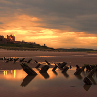 Buy canvas prints of Bamburgh Wreck by Northeast Images Daniel Dent